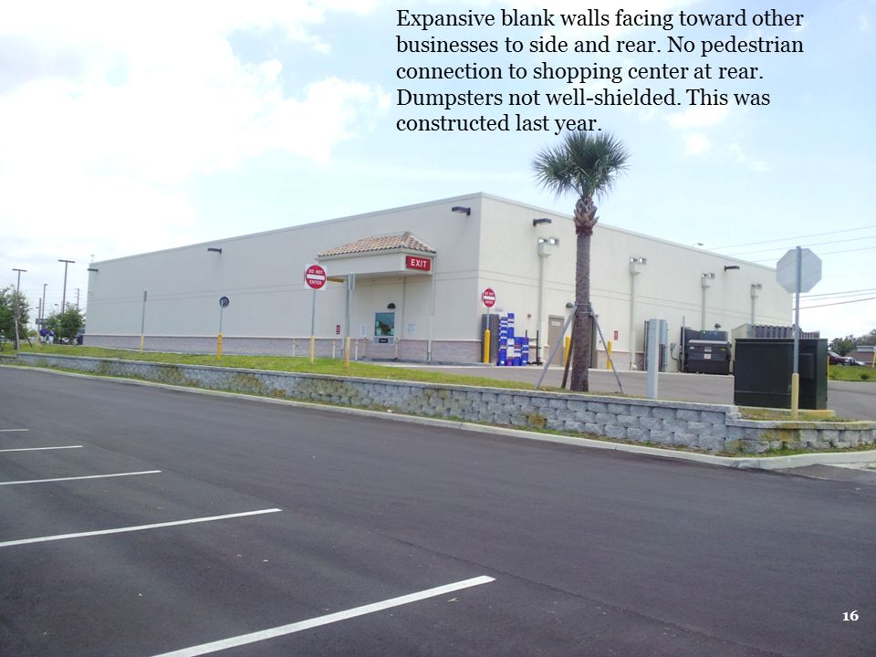 Expansive blank walls facing toward other businesses to side and rear
