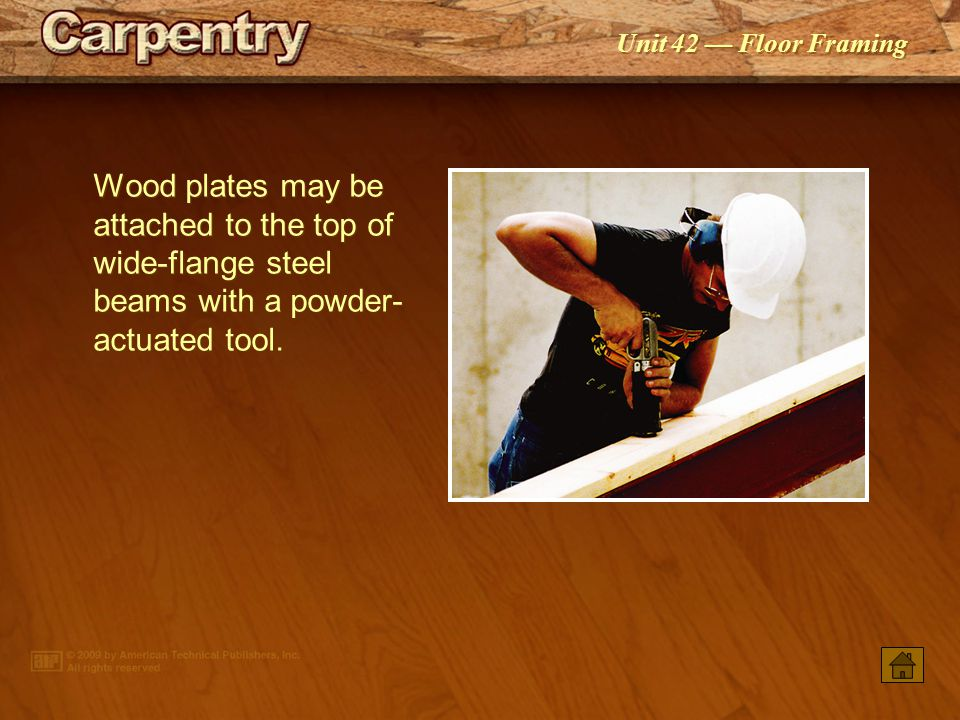 Wood plates may be attached to the top of wide-flange steel beams with a powder-actuated tool.