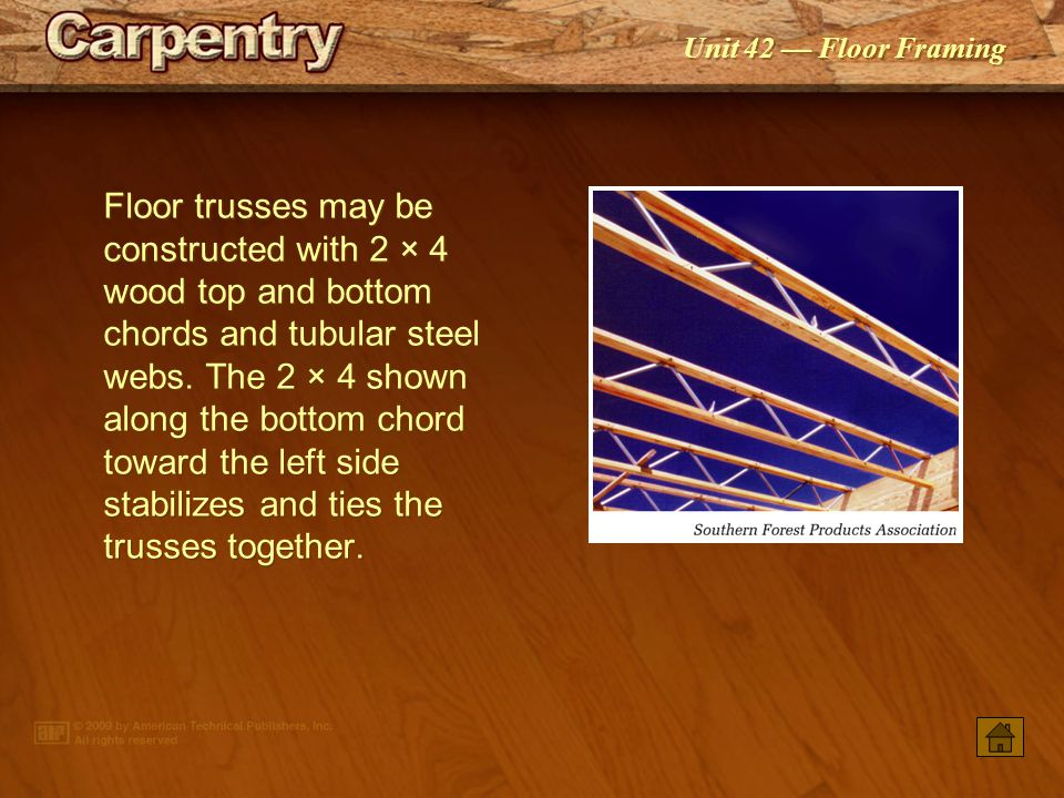 Floor trusses may be constructed with 2 × 4 wood top and bottom chords and tubular steel webs. The 2 × 4 shown along the bottom chord toward the left side stabilizes and ties the trusses together.