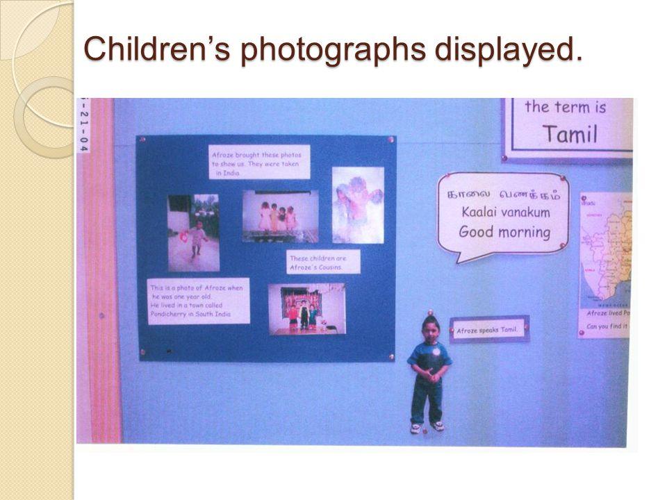Children's photographs displayed.