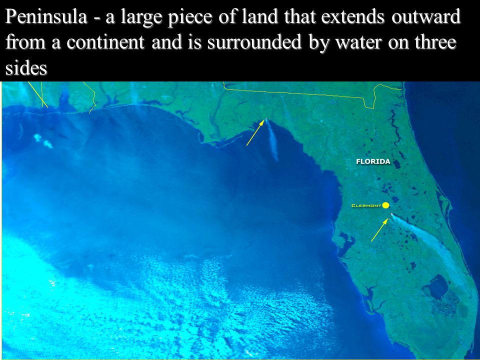 Peninsula - a large piece of land that extends outward from a continent and is surrounded by water on three sides