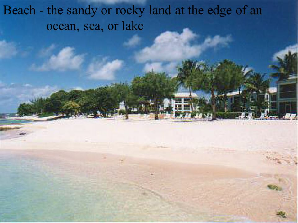 Beach - the sandy or rocky land at the edge of an ocean, sea, or lake