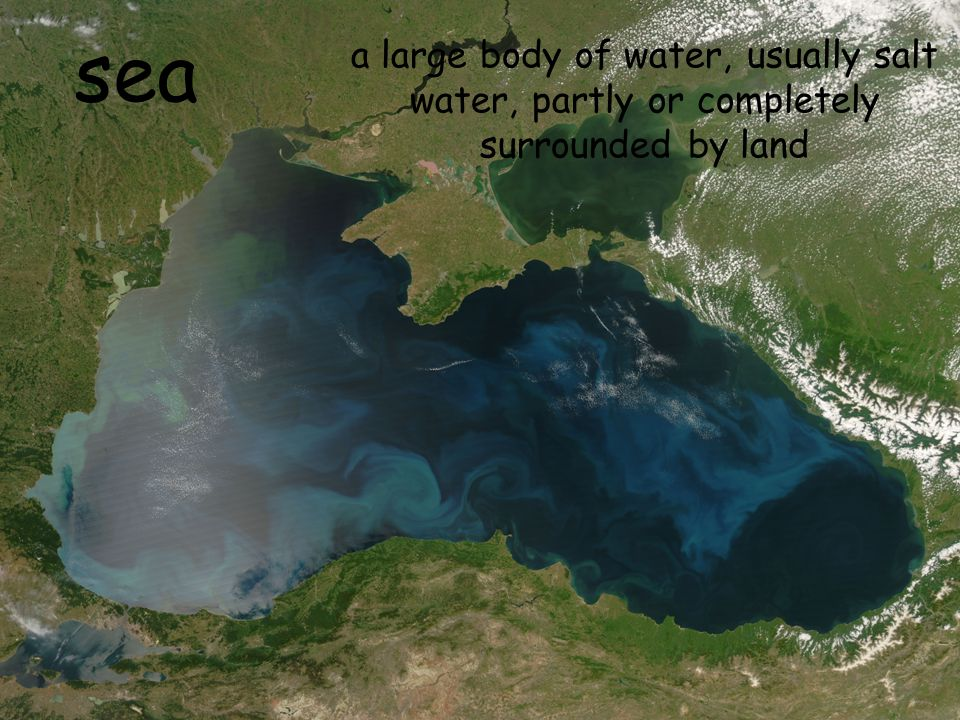 sea a large body of water, usually salt water, partly or completely surrounded by land