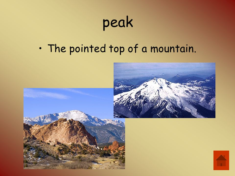 The pointed top of a mountain.