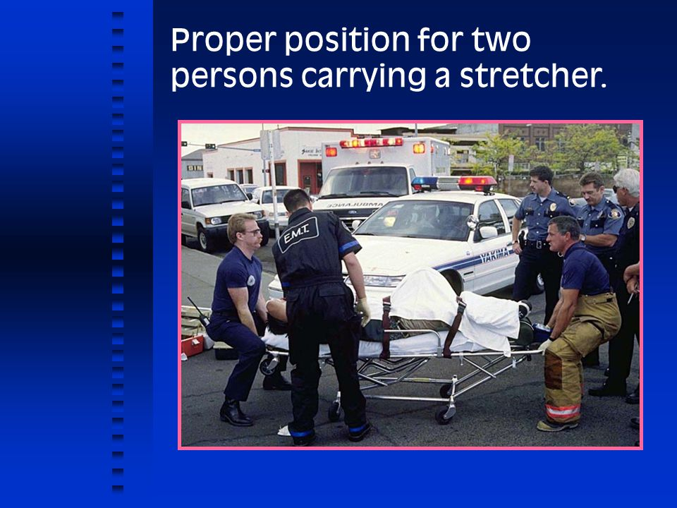Proper position for two persons carrying a stretcher.