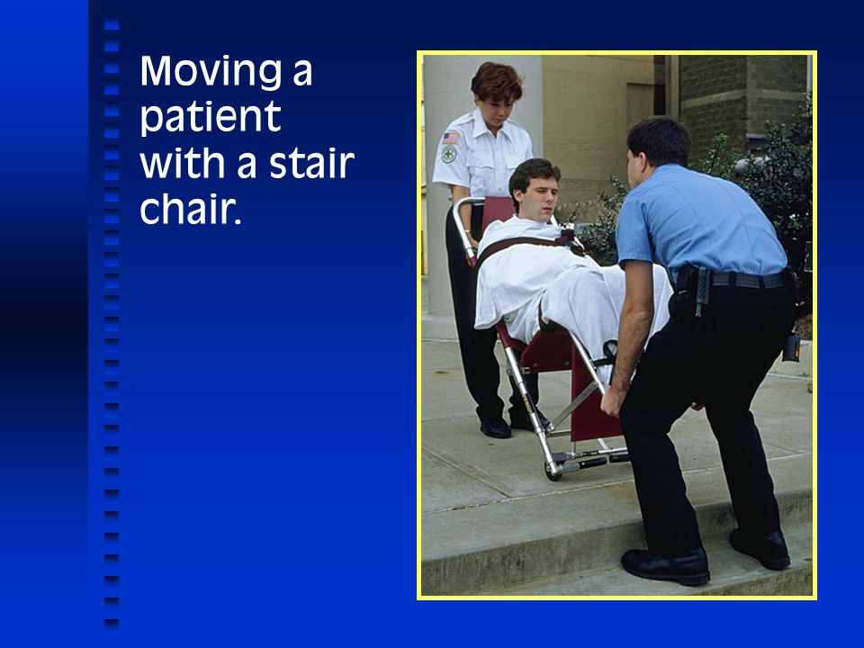 Moving a patient with a stair chair.