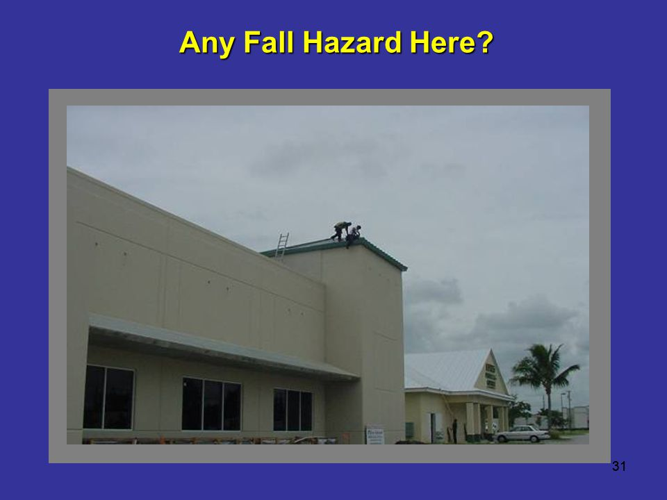 Any Fall Hazard Here Workers are installing a new metal roof. 31 31