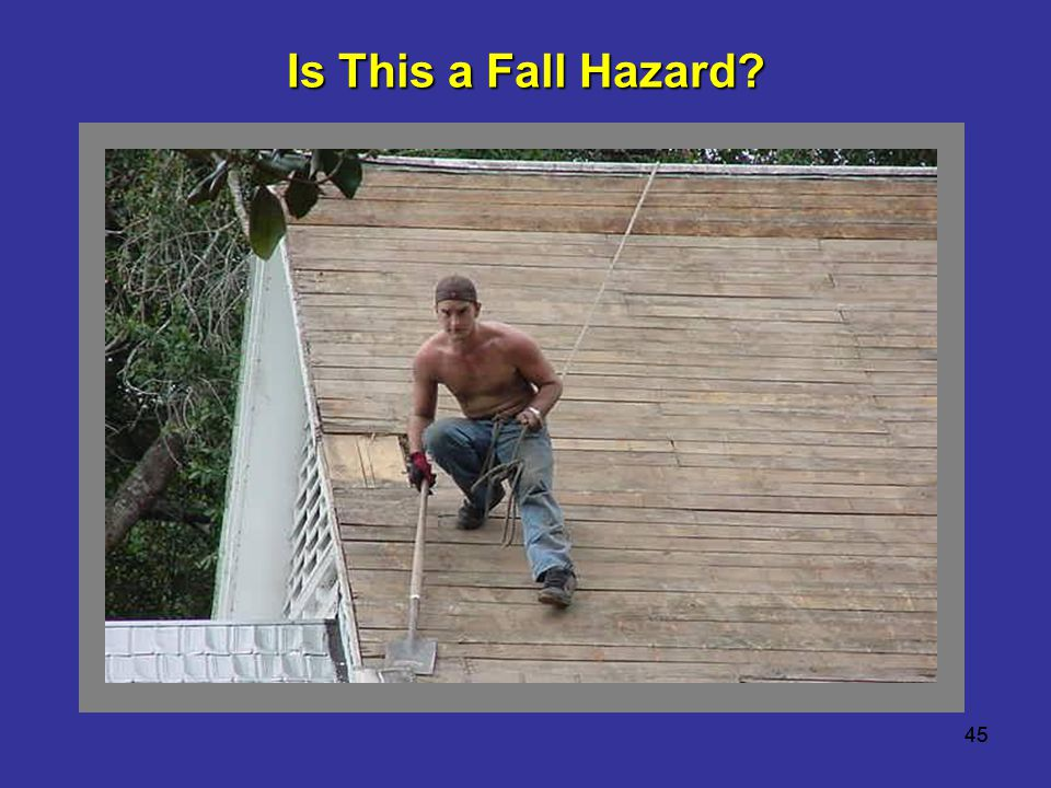 Is This a Fall Hazard Worker working on an 8:12 pitch roof with the lifeline tied to his waist as fall protection.