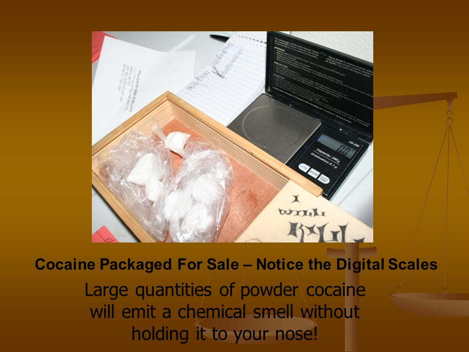 Cocaine Packaged For Sale – Notice the Digital Scales