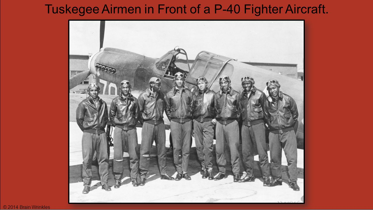 Tuskegee Airmen in Front of a P-40 Fighter Aircraft.