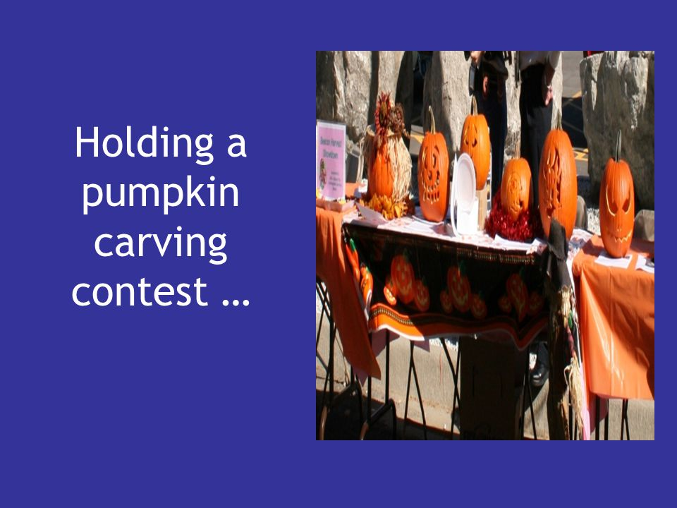 Holding a pumpkin carving contest …