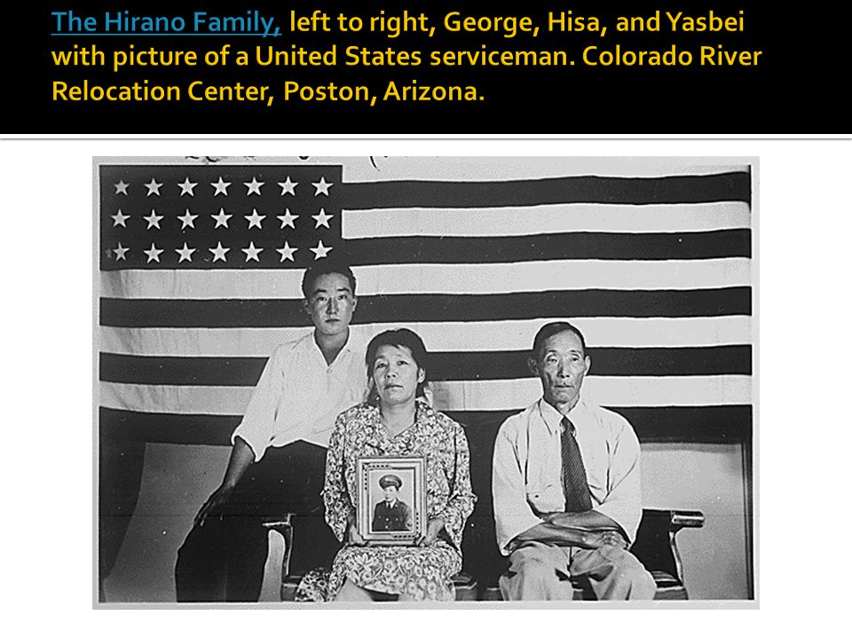 The Hirano Family, left to right, George, Hisa, and Yasbei with picture of a United States serviceman.