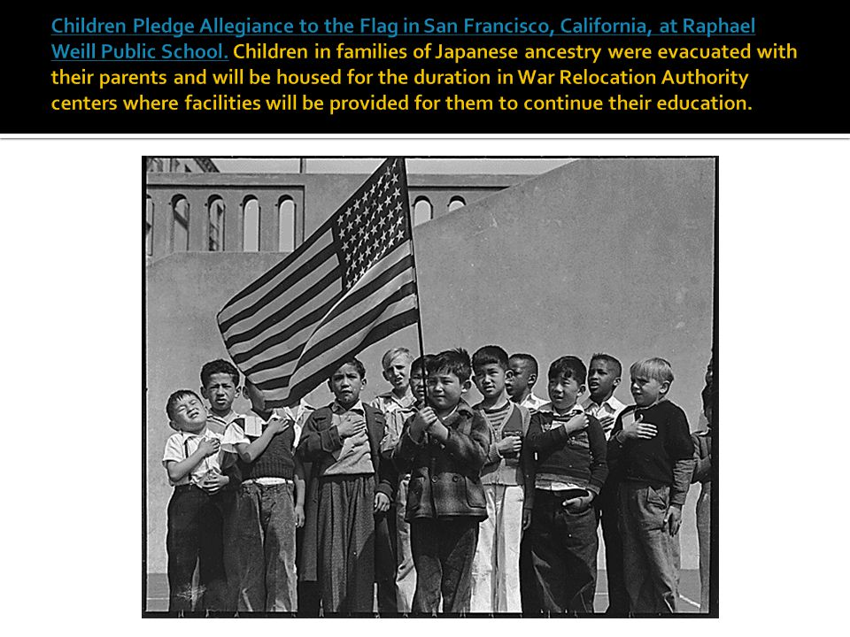 Children Pledge Allegiance to the Flag in San Francisco, California, at Raphael Weill Public School.