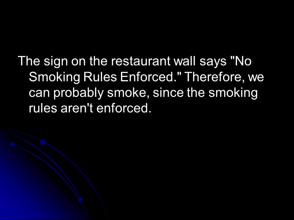 The sign on the restaurant wall says No Smoking Rules Enforced