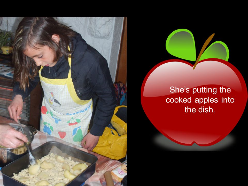 She's putting the cooked apples into the dish.