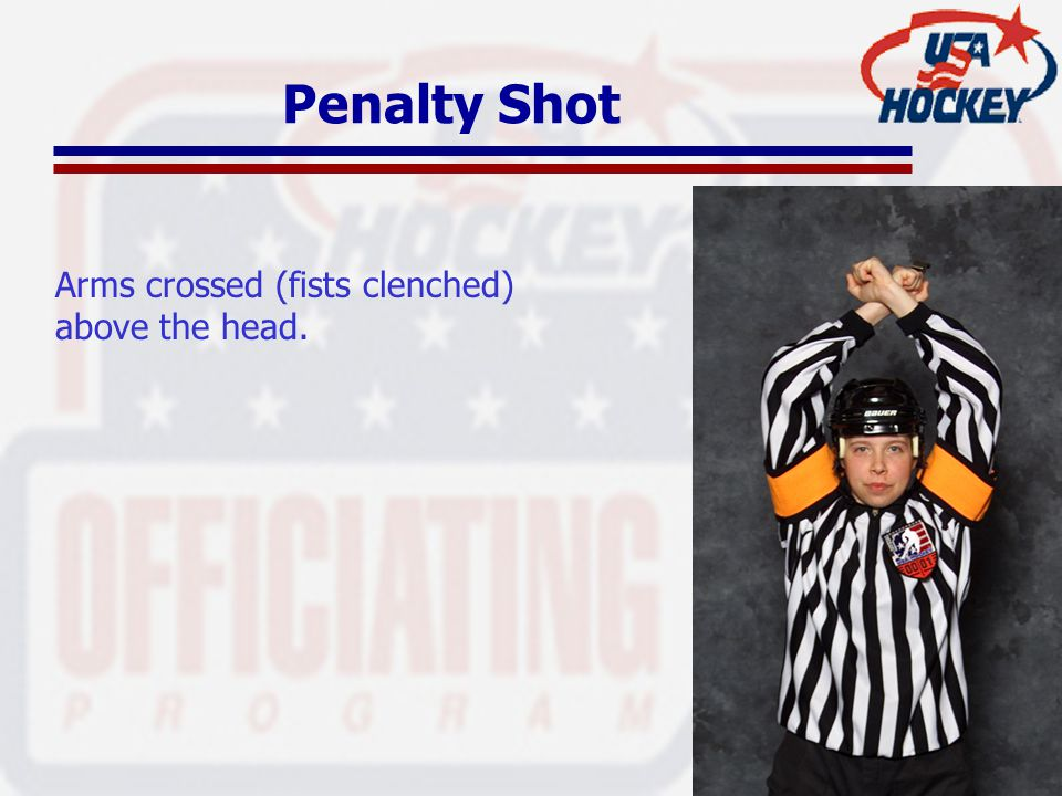 Penalty Shot Arms crossed (fists clenched) above the head.