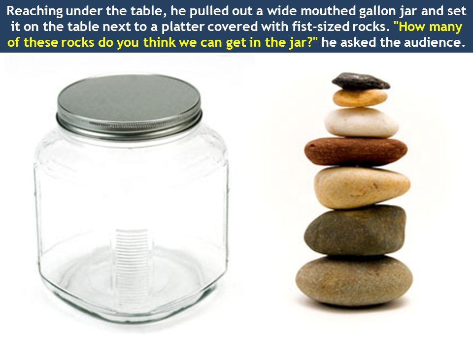 Reaching under the table, he pulled out a wide mouthed gallon jar and set