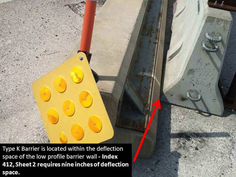 Type K Barrier is located within the deflection space of the low profile barrier wall - Index 412, Sheet 2 requires nine inches of deflection space.