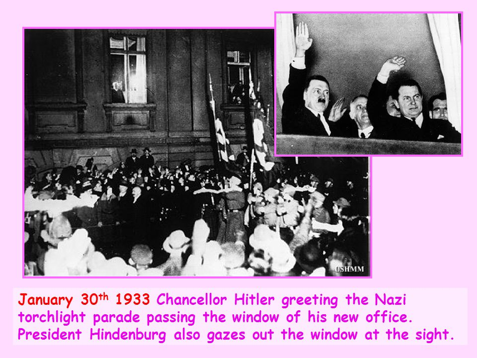 January 30th 1933 Chancellor Hitler greeting the Nazi torchlight parade passing the window of his new office.