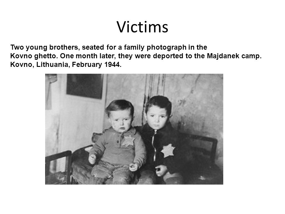Victims Two young brothers, seated for a family photograph in the
