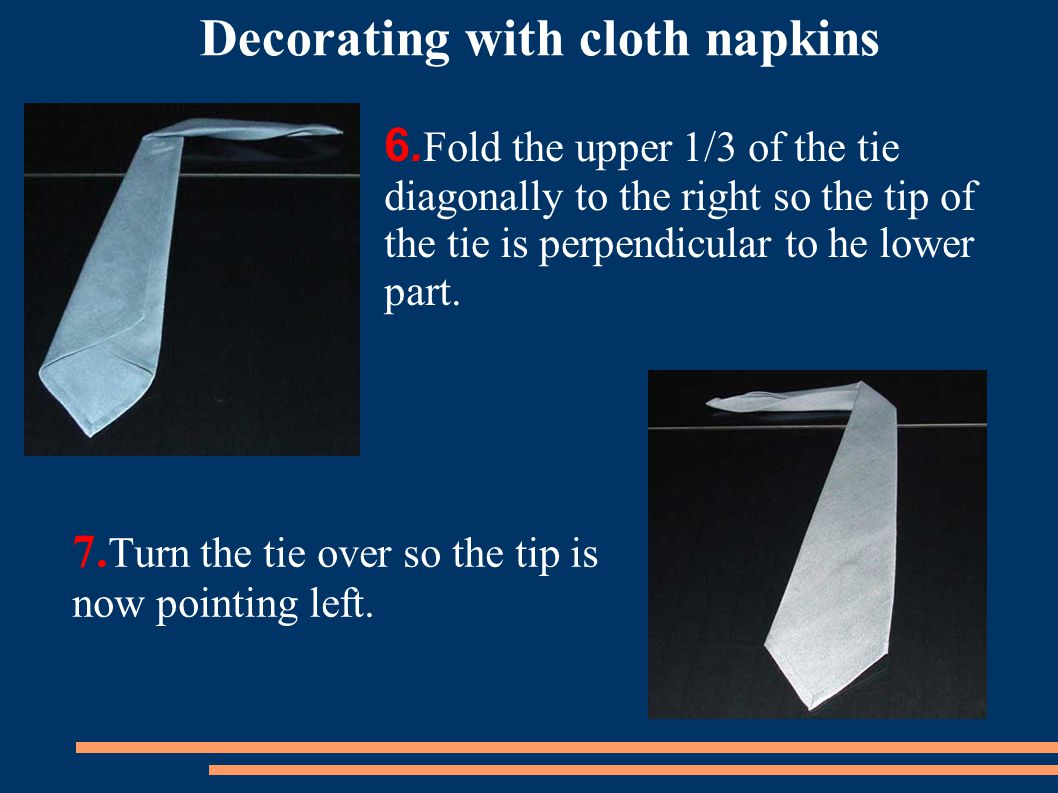 7.Turn the tie over so the tip is now pointing left.