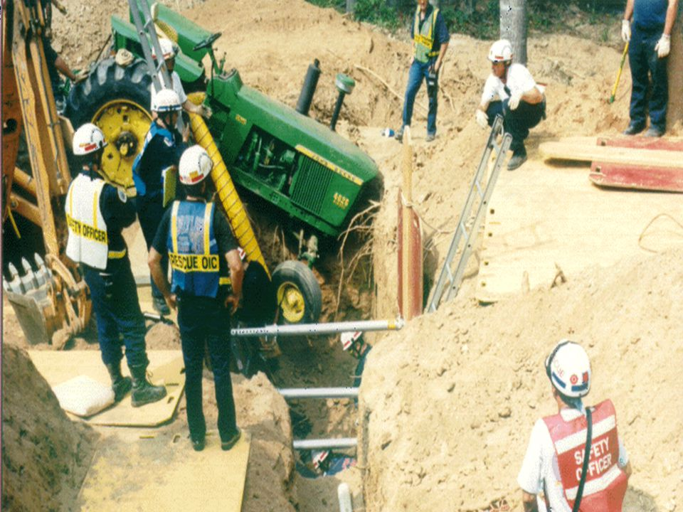 Victim was ejected from tractor into the trench (lower center )