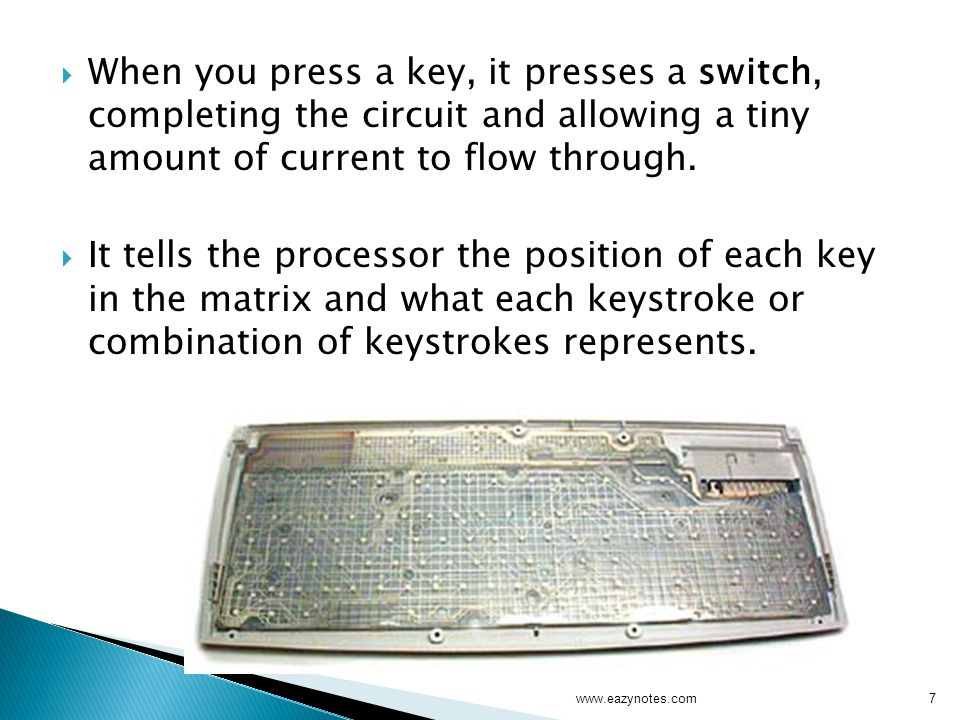 When you press a key, it presses a switch, completing the circuit and allowing a tiny amount of current to flow through.