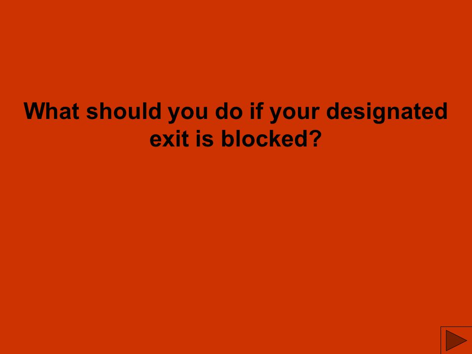 What should you do if your designated exit is blocked