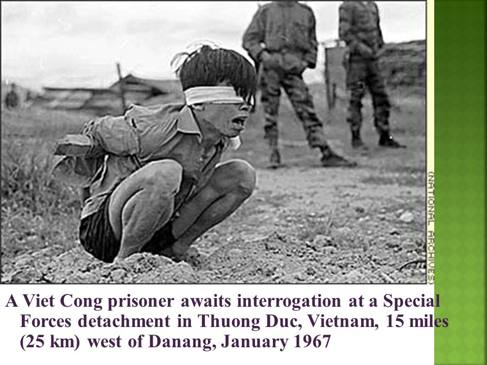 A Viet Cong prisoner awaits interrogation at a Special Forces detachment in Thuong Duc, Vietnam, 15 miles (25 km) west of Danang, January 1967