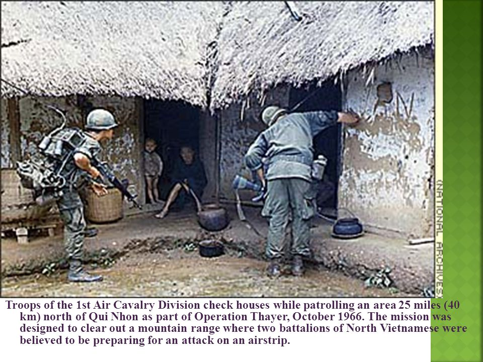 Troops of the 1st Air Cavalry Division check houses while patrolling an area 25 miles (40 km) north of Qui Nhon as part of Operation Thayer, October 1966.
