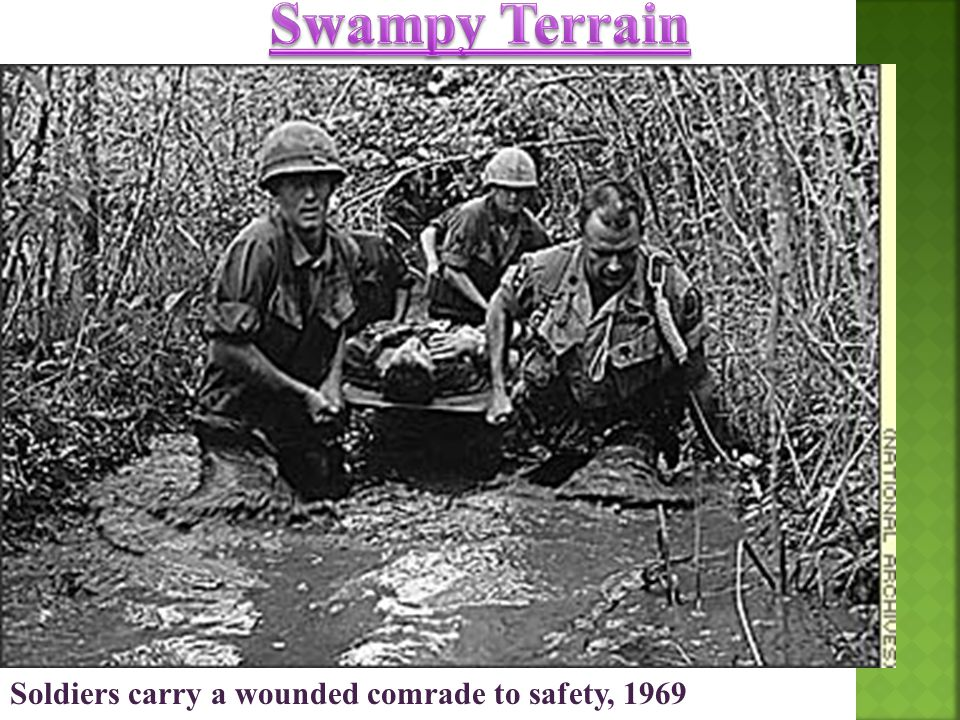 Swampy Terrain Soldiers carry a wounded comrade to safety, 1969