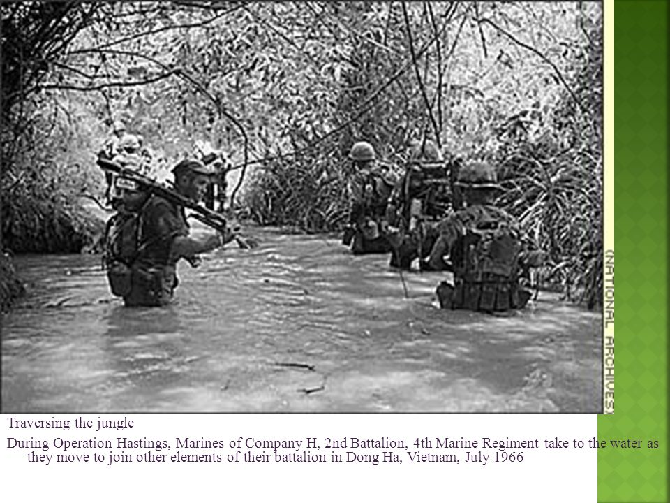 Traversing the jungle During Operation Hastings, Marines of Company H, 2nd Battalion, 4th Marine Regiment take to the water as they move to join other elements of their battalion in Dong Ha, Vietnam, July 1966