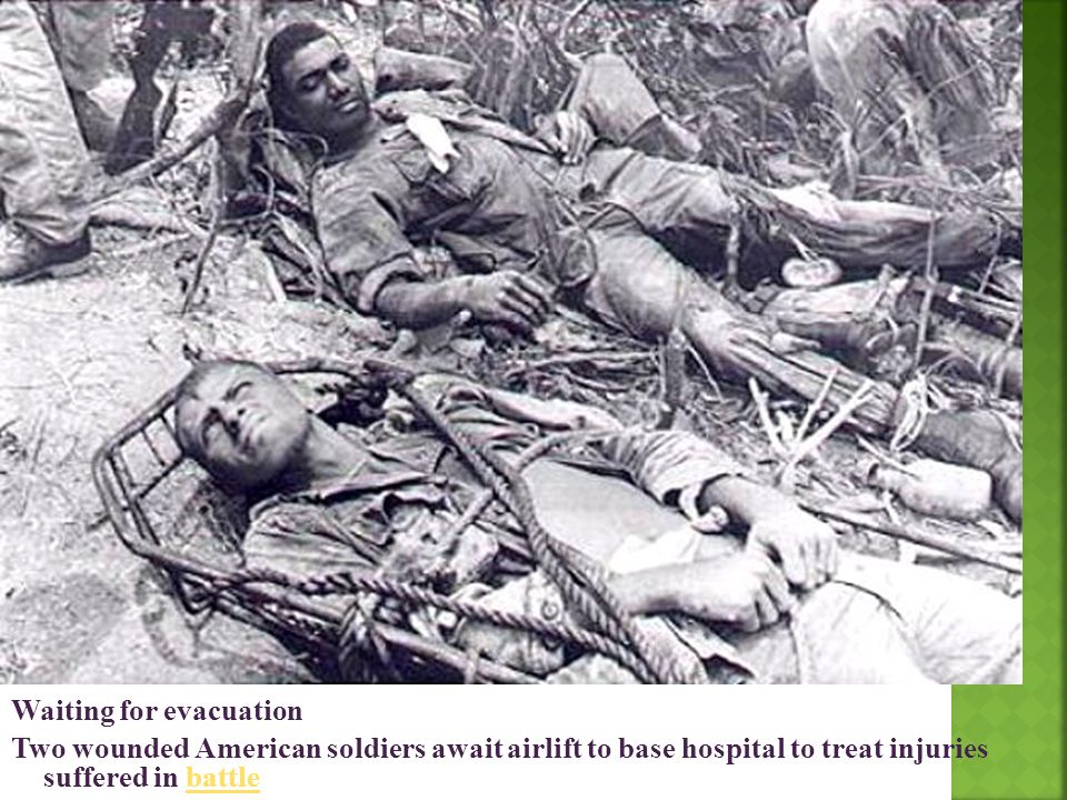 Waiting for evacuation Two wounded American soldiers await airlift to base hospital to treat injuries suffered in battle