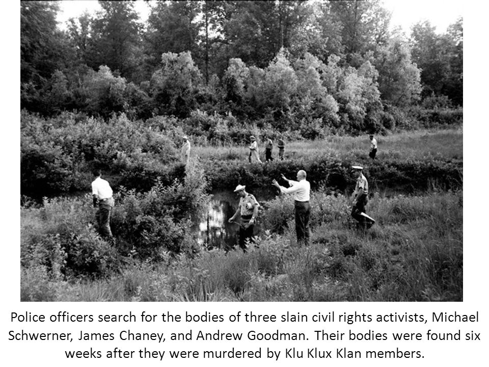 Police officers search for the bodies of three slain civil rights activists, Michael Schwerner, James Chaney, and Andrew Goodman.