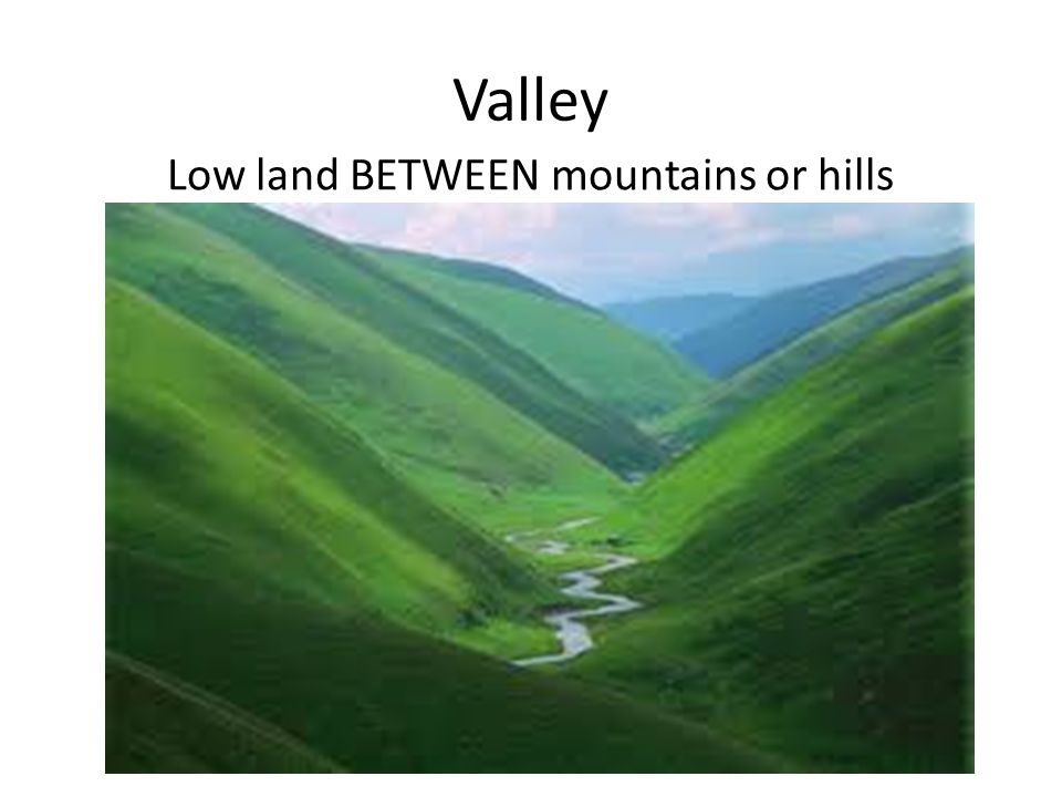 Low land BETWEEN mountains or hills