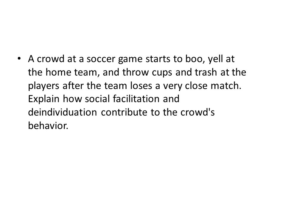 A crowd at a soccer game starts to boo, yell at the home team, and throw cups and trash at the players after the team loses a very close match.