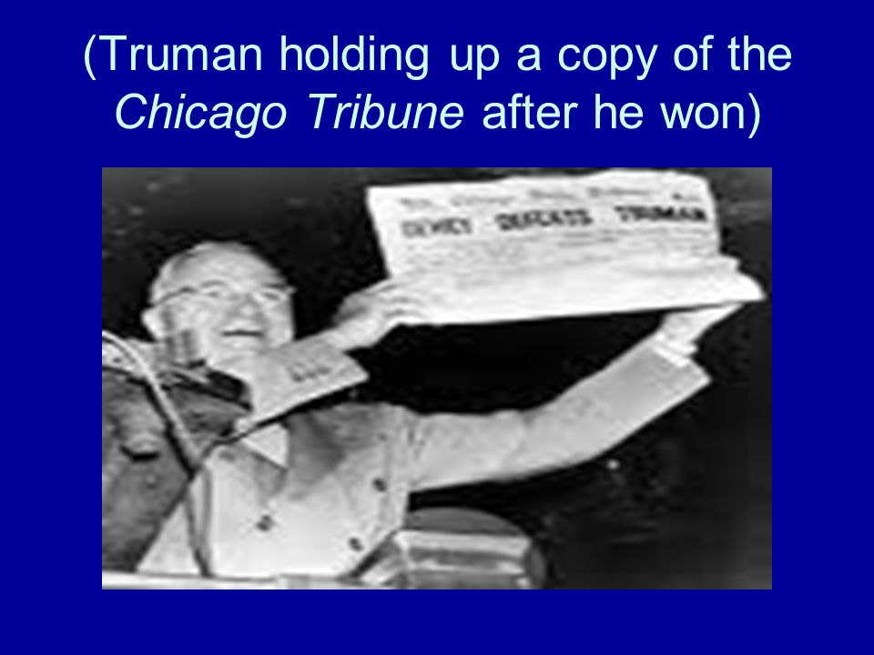(Truman holding up a copy of the Chicago Tribune after he won)