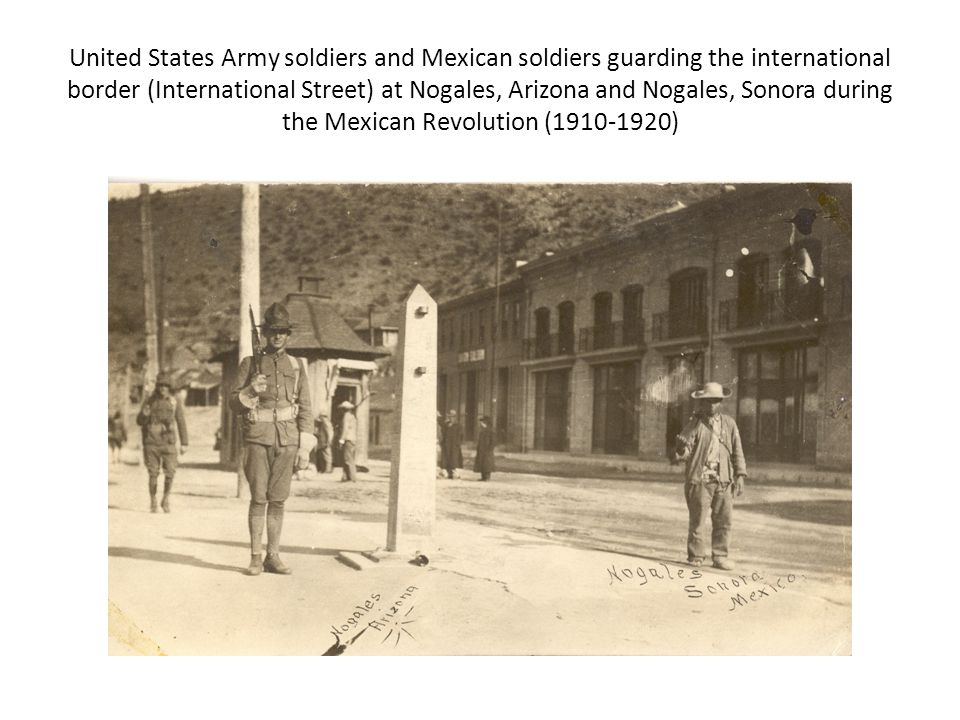 United States Army soldiers and Mexican soldiers guarding the international border (International Street) at Nogales, Arizona and Nogales, Sonora during the Mexican Revolution (1910-1920)