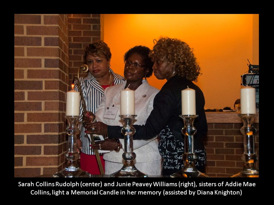 Sarah Collins Rudolph (center) and Junie Peavey Williams (right), sisters of Addie Mae Collins, light a Memorial Candle in her memory (assisted by Diana Knighton)