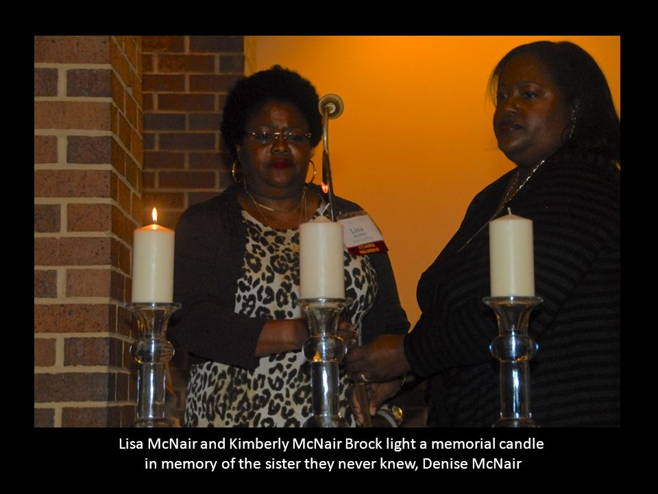 Lisa McNair and Kimberly McNair Brock light a memorial candle