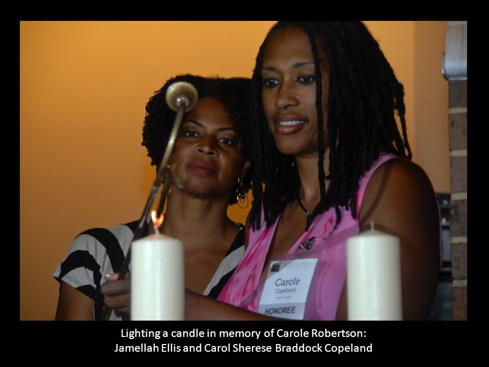 Lighting a candle in memory of Carole Robertson: