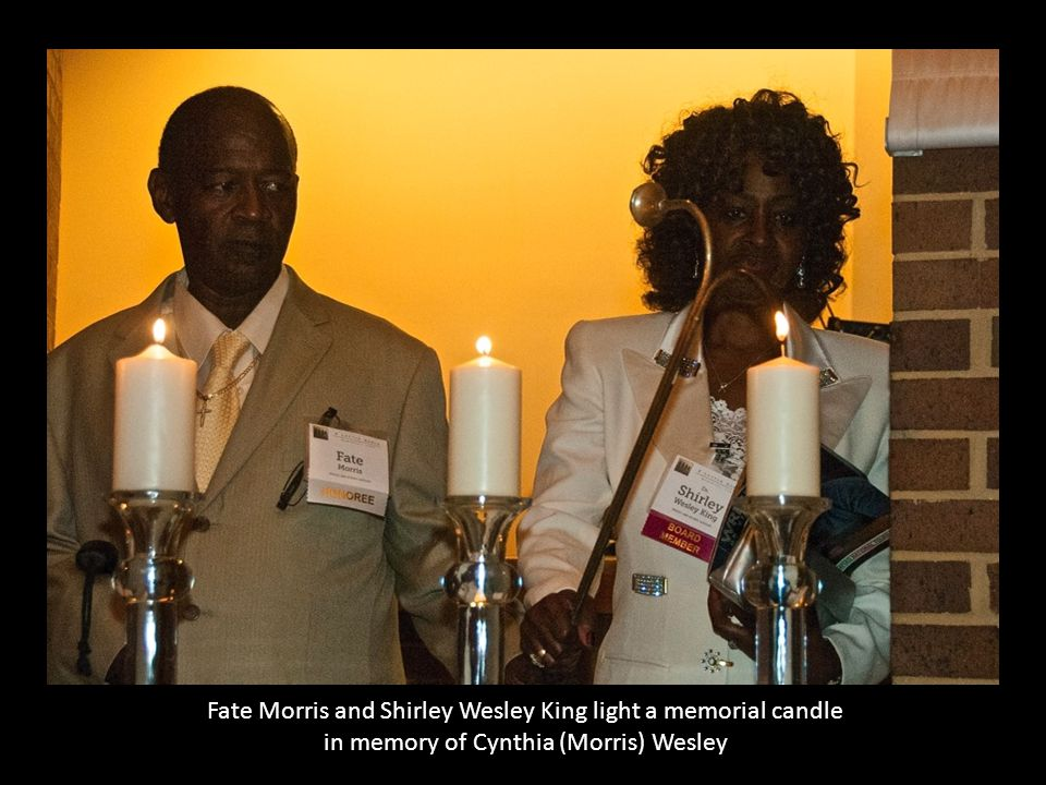 Fate Morris and Shirley Wesley King light a memorial candle