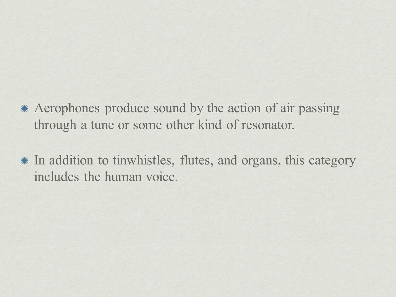 Aerophones produce sound by the action of air passing through a tune or some other kind of resonator.