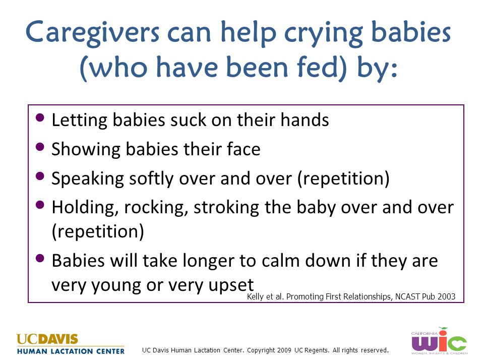 Caregivers can help crying babies (who have been fed) by: