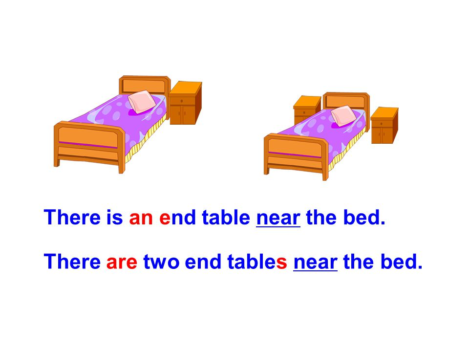 There is an end table near the bed.