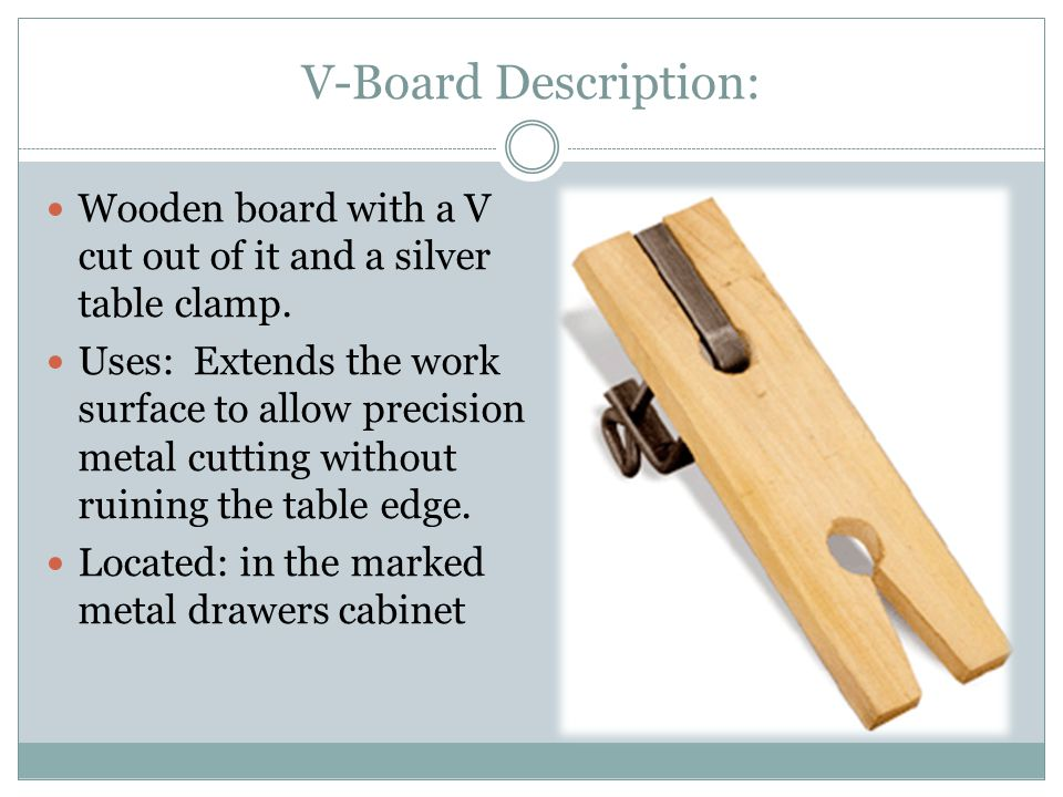 V-Board Description: Wooden board with a V cut out of it and a silver table clamp.