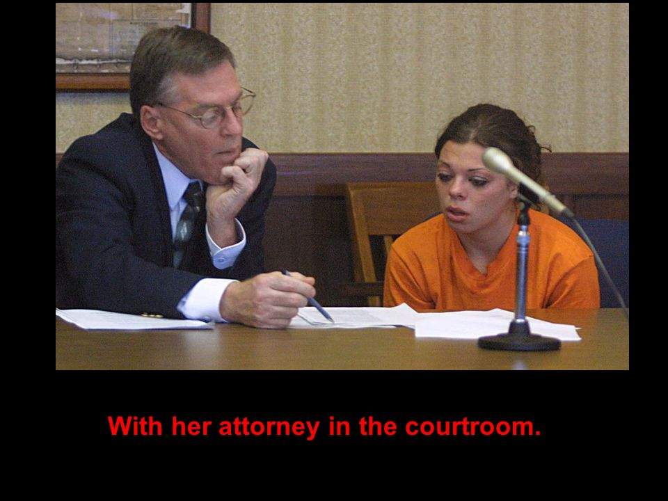 With her attorney in the courtroom.