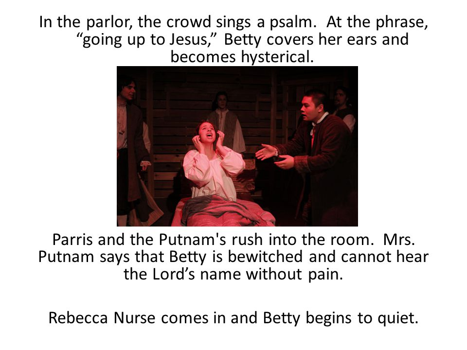 In the parlor, the crowd sings a psalm
