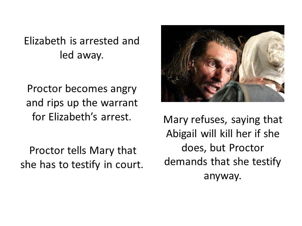 Elizabeth is arrested and led away.