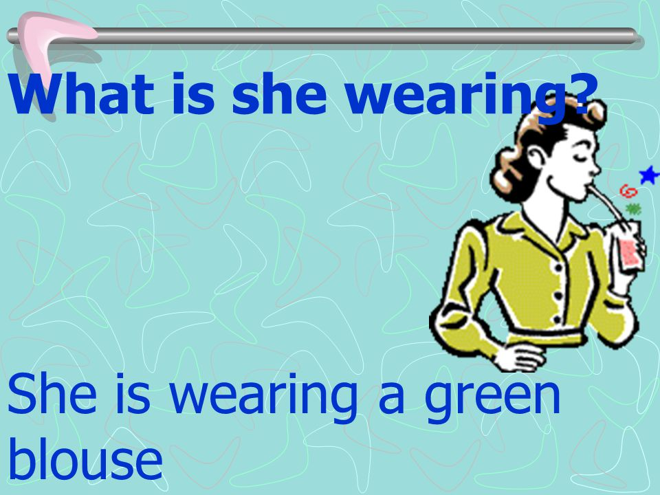 What is she wearing She is wearing a green blouse